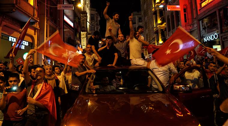 People chant slogans during a pro-government rally in central Istanbul's Taksim square, Saturday, July 16, 2016. Forces loyal to Turkish President Recep Tayyip Erdogan quashed a coup attempt in a night of explosions, air battles and gunfire that left some hundreds of people dead and scores of others wounded Saturday. (AP Photo/Bram Janssen)